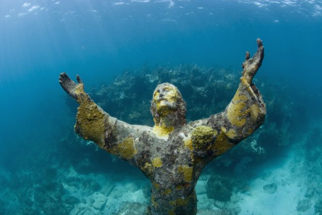 The open arms of Christ of the Abyss statue, located underwater at Key Largo Dry Rocks, Key Largo, Florida, September 9, 2007 offer peace to those who see the statue.  The bronze statue was placed near the coral reef in August of 1965 after being donated to the Underwater Society of America.