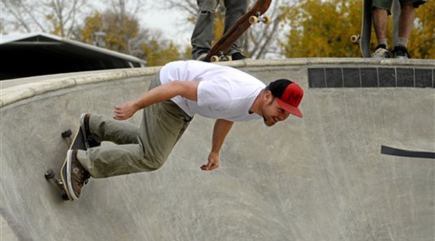 Jeff Ament, bassist for the band Pearl Jam, skates at the new skate park he funded in his home town of Big Sandy, Mont., Wednesday, Oct. 13, 2010. (AP Photo/Great Falls Tribune, Rion Sanders)